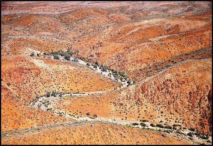 Aerial view of the Northern Flinders Ranges, containing incised creek valleys and gorges, where Warratyi rock shelter was discovered.
