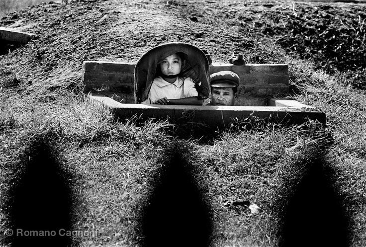 Vietnam, 1965 :: Young girl and her father inside a bunker Romano Cagnoni