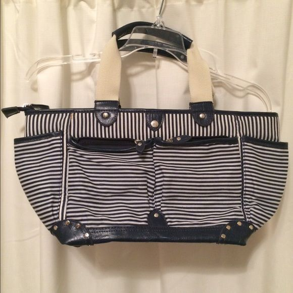 Sarah Jessica Parker Bitten Nautical Purse Can be worn on shoulder or as shown in picture. 6 large pockets on the outside, 4 of which are zippered. Holds plenty and is super cute! Inside of one pocket is stained with lipstick. Might come off with a wash. Not very visible from the outside Bitten Bags Satchels