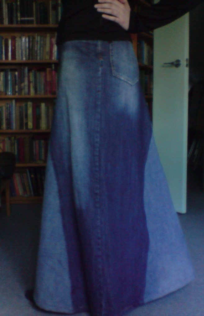 I love the skirt i made using this tutorial. I went to my local Goodwill and found the two widest-legged pairs of jeans that were also the closest in colour and woohoo!! Amazing skirt!   DIY jean skirt