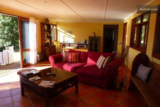 Living room/dining/kitchenette...opens to deck with garden view