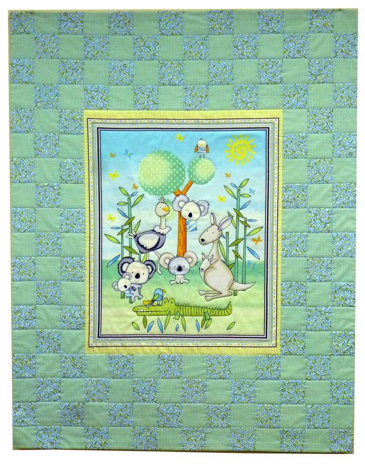 """Детское лоскутное одеяло мятного цвета с коалами и кунгуру. Покупка на сайте http://sewlegko.ru/category/detskoe-odeyalo-masterskaya-sewlegko/ Ручная работа, выполненная в мастерской """"Шить легко"""" Ткань 100% хлопок ( США). Наполнитель 100% хлопок. Размер 126 х 98 см Одеяло тонкое, но тепленькое, т.к. внутри натуральный хлопок. Им можно укрываться во время сна или использовать как покрывало. В маленькой кроватке такое одеялко будет очень хорошо смотреться и приучит ребенка к порядку."""