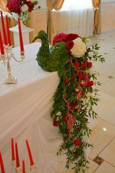 A unique Christmas flower arrangement. Eye catching.