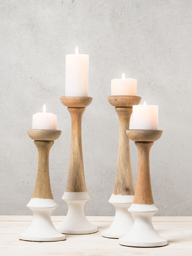 Set the mood for any evening occasion with our stylish wood and white candlesticks. www.shf.co.za #candle #romantic #love