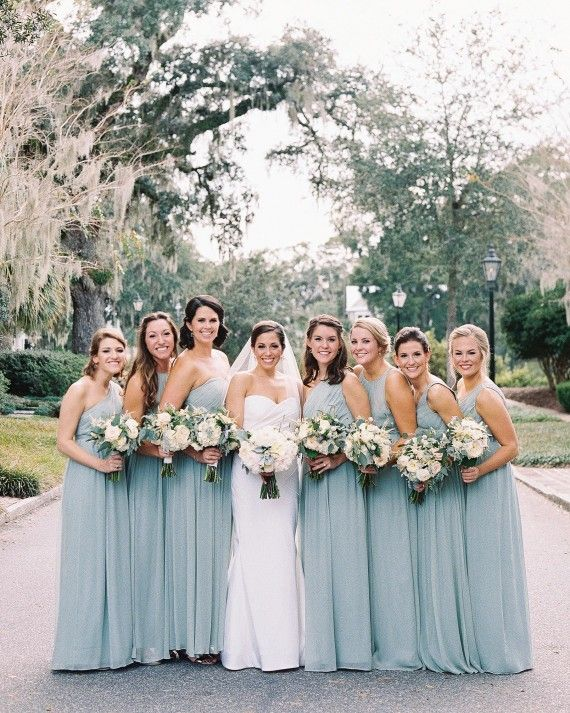 Bridesmaids wore various styles of chiffonJ.Crew dresses in the bride's favorite color—dusty shale.
