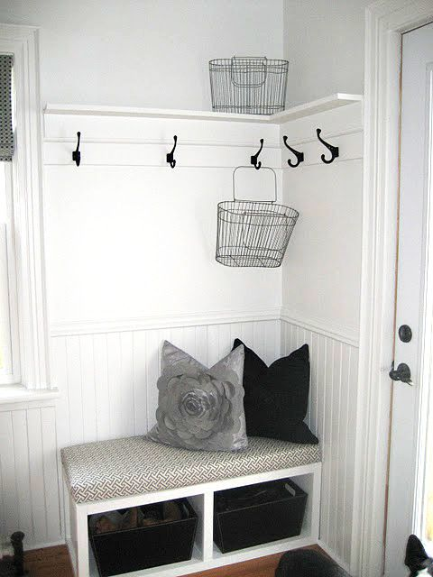very small mudroom. corner entryway idea. beadboard and hooks with bench