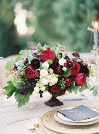 Rich, moody hued centerpiece: http://www.stylemepretty.com/2015/01/29/moody-romantic-outdoor-wedding-inspiration/ | Photography: Kurt Boomer - http://www.kurtboomer.com/