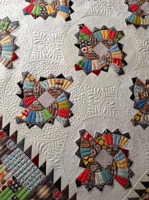 Twirling Fans Quilt. I would Never make this, but coming from quilting genes, I recognize this a Beautiful.