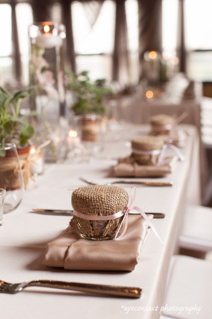 Rustic table setting, burlap covered jams and potted herbs are a personalized gift idea for your guests! Styled by Simply Perfect Weddings. photo: www.eyecontact.ca