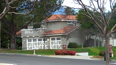 GRAY HOUSE WITH RED ROOF TILES