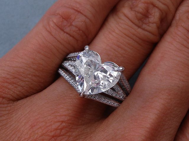 4.12 ctw Heart Shape Diamond Engagement Ring. It has a beautiful 3.32 ct H color/SI1 clarity (Fracture Filled), Heart Shape center diamond. Set in a beautifully custom designed 14k White Gold setting, this ring is listed for $17,990.  Follow this link to view this listing on our website:  http://www.bigdiamondsusa.com/4ctwheshdien.html