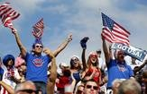 Supporters of Jacob Gibb and Sean Rosenthal of the U.S. cheer before their men's preliminary round beach volleyball match against Latvia's Aleksandrs Samoilovs and Ruslans Sorokins at Horse Guards Parade during the London 2012 Olympic Games. — Marcelo Del Pozo, Reuters, Aug. 1, 2012