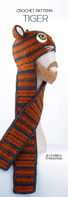 "TIGER HAT CROCHET PATTERN  from the book ""Amigurumi Animal Hats Growing Up"" by Linda Wright. 20 crocheted animal hat patterns for Ages 6-Adult. Book available at Amazon.com and BarnesandNoble.com. http://www.amazon.com/dp/1937564991/ Ski or snowboard hat; team mascot hat; campus hat; anywhere hat. Can be made with ear flaps instead of scarves. Nice Detroit Tigers hat, Princeton Tigers hat or RIT Tigers hat for fans of these teams."
