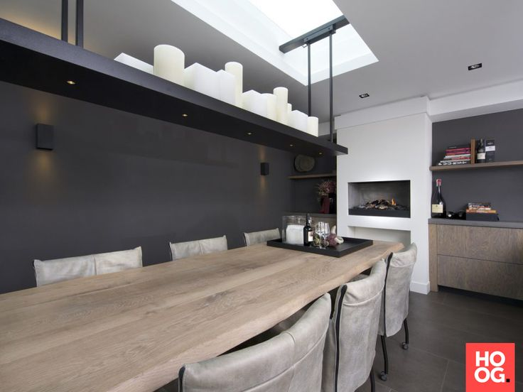 Houten eettafel met accessoires en luxe zitstoelen Küchen - offene küche wohnzimmer abtrennen