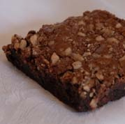 Our Toffee Bar Crunch Fudge Brownie contains milk chocolate, toffee chunks on top and amazing flavor throughout!