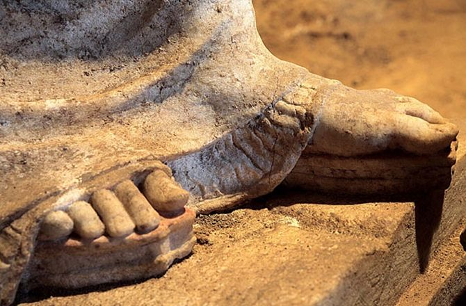 Statues wear high soled red and yellow sandals. Greek Tomb's Female Sculptures Fully Revealed : Discovery News