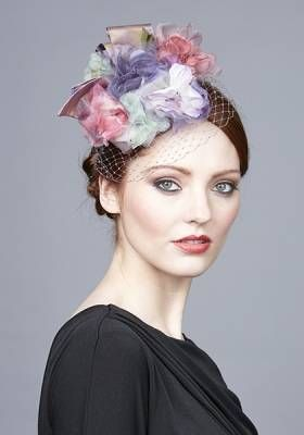 Multi flower pillbox with lilac bow and veil