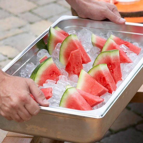 Keep fruit fresh in a metal tray packed with ice at your next outdoor party! More how-to organize outdoor party tips: http://www.bhg.com/party/birthday/themes/how-to-organize-outdoor-party-food-and-drinks/?socsrc=bhgpin063013icetray=3