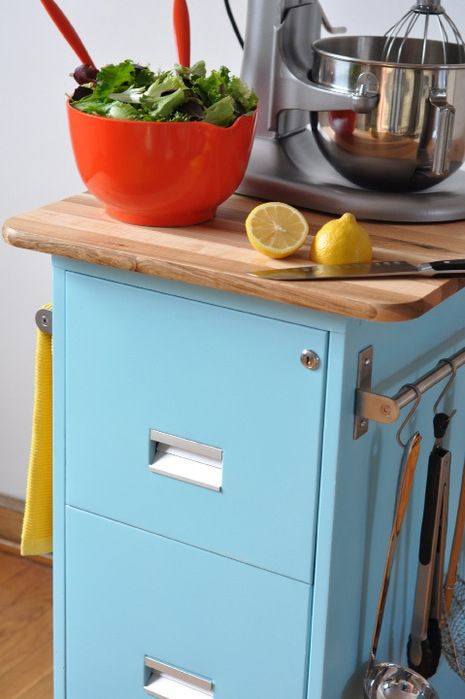 A bright paint job, butcherblock top, and bar for hanging storage makes this a handy station for a tiny kitchen.