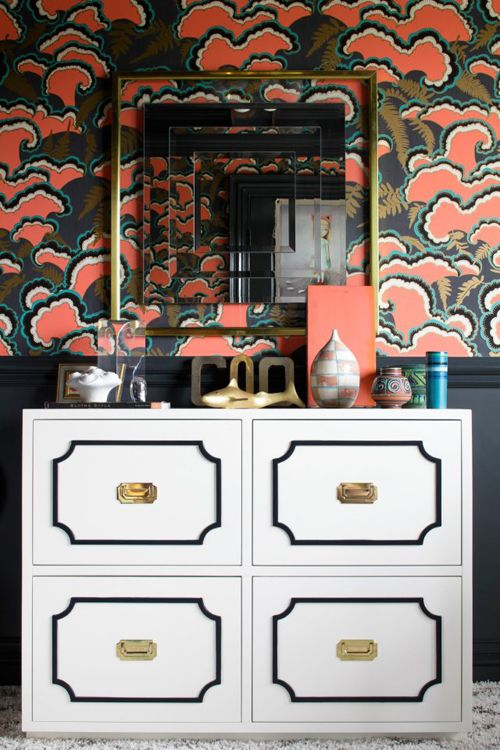 Bold, yet chic.  Obsessed with the brass frame-mirror effect on the colorful wallpaper.  White vintage dresser keeps the space from feeling too dark.