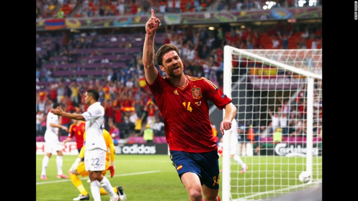 Xabi Alonso of Spain celebrates after scoring the first goal during the quarterfinal match between Spain and France. CNN.com