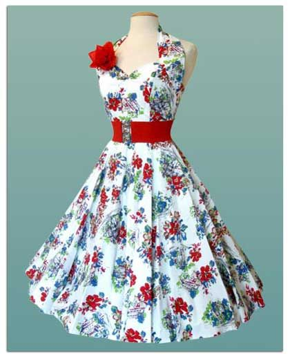 "white dress with blue and red flowers and rosette. (the phrase ""blue flowers with red thorns"" comes to mind...)"