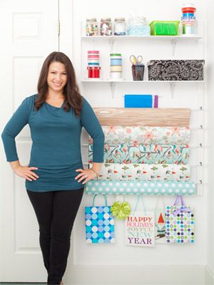 Gift Wrapping Storage Wall - Cup hooks holding the dowels make it easy to switch out paper seasonally or when a roll is finished.