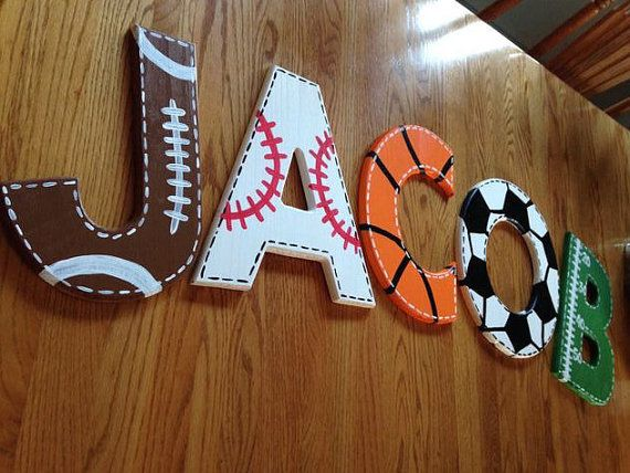BY FAR MY MOST POPULAR ITEM! For your little sports star in your life! These baseball, football, soccer and basketball letters are sure to make them smile! Made from 9 1/2 inch wooden letters that can come either in one letter, initials, or even a full name! The letters can come in any of these designs -Baseball -Basketball -Football -Soccer -Football Field -Hockey (net and stick) -Golf -Tennis -Soccer Net When ordering be sure to leave the letters that youd like in the message box and what…