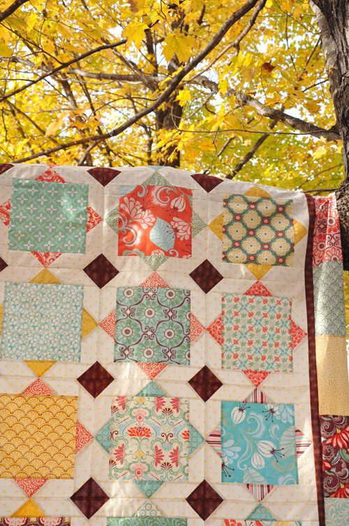 """Square Dance"" a big block quilt to show off the large print fabrics and fat quarter fabrics you love."