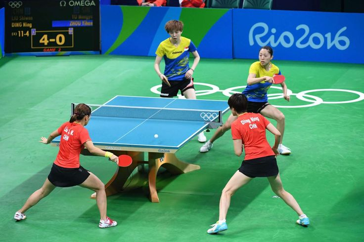 Mengyu Yu and Yihan Zhou of Singapore compete against Shiwen Liu and Ning Ding of China during the women's team semifinals in the Rio 2016 Summer Olympic Games at Riocentro - Pavilion 3.        -  Best images from Aug. 15 at the Rio Olympics:  2016
