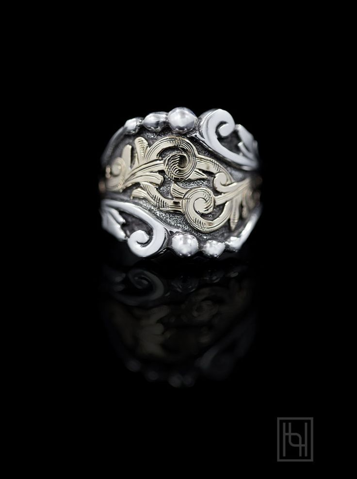 Enjoy two-toned harmony and a Victorian Era inspired design with the Victorian Scroll Ring.  What you'll love: golden scroll arrangement and stylized leaf patterns.  Sterling Silver & 1/10th 10k Yellow Gold with oxidization.  Now available at hyosilver.com. SKU: R062, $245.