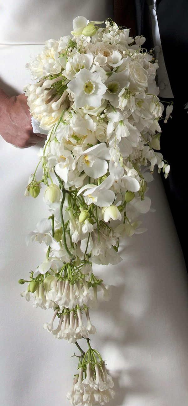 "I think the trailing part would look really pretty with bleeding hearts.  ""The Crown Princess´s bridal bouquet includes the following flowers: lily of the valley, rose, phalaenopsis orchid, peony, clematis, cosmos, wax flower, sweet pea, dicentra formosa, Mårbacka pelargonium, Amazon lily, gardenia, azalea, bleeding heart and the traditional myrtle from Sofiero."""