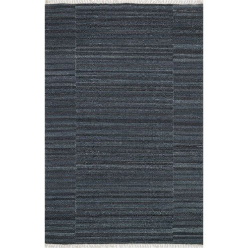 The Anzio Collection, an all-wool, solid-colored flat weave from India, offers a transitional, tonal look in a choice of: aqua, apple, pink, denim, charcoal, moss, purple and blue. Anzio is updated with the addition of fringe, which is making a comeback in new rugs.  Care Instructions: Clean spills immediately by blotting with a clean sponge or cloth. Professional cleaning recommended. Rug pad recommended for use on hard floor. For vacuuming, use a vacuum cleaner without a beater bar or…