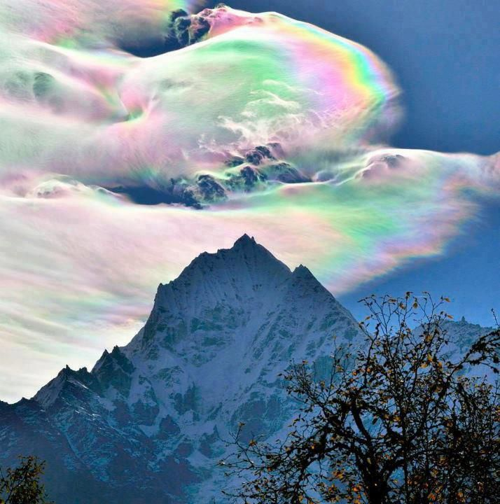 Wonderful Rainbow cloud over the Himalayas. Rare formation.
