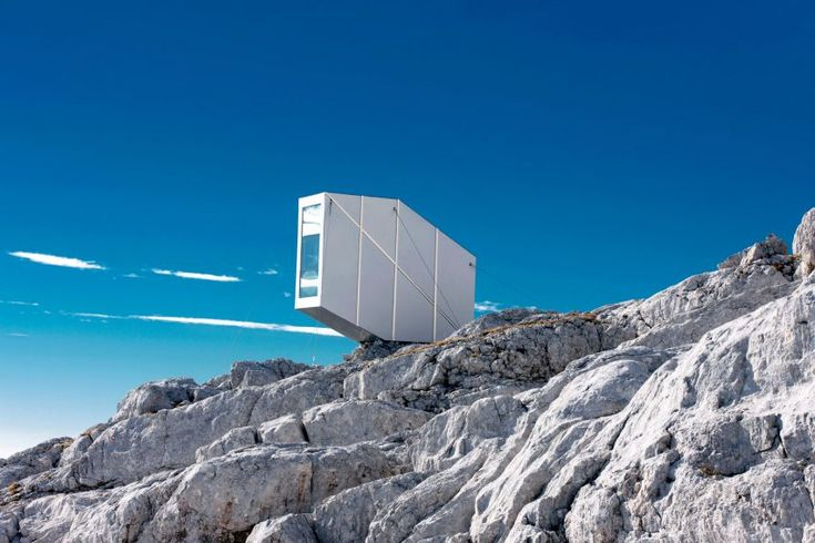 Cantilevering Alpine shelter by OFIS offers shelter to Slovenian climbers