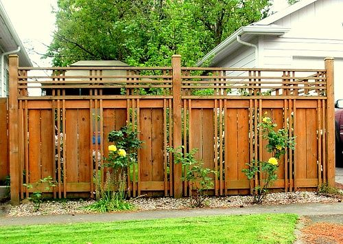 Lovely craftsman style fence.- I would like this where we have our climbing plants                                                                                                                                                     More