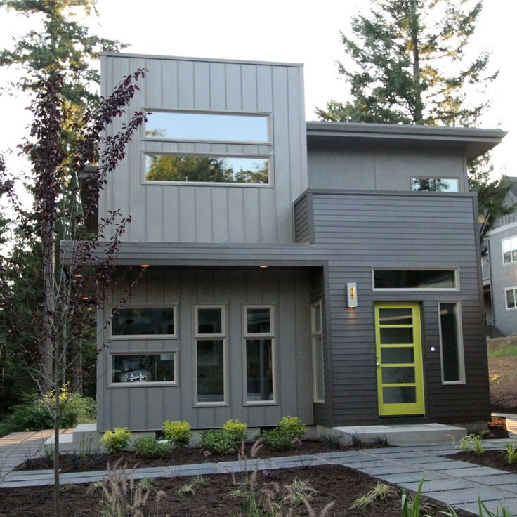 Modern Exterior Of Home With Pathway Transom Window Exterior Tile Floors French Doors