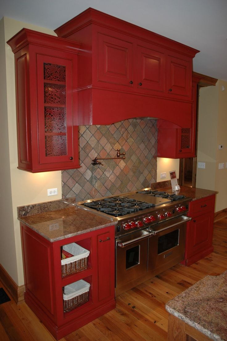 Red Kitchen- i will always have a red kitchen...i love this too! Needs more white for dimension, but beautiful set up!!