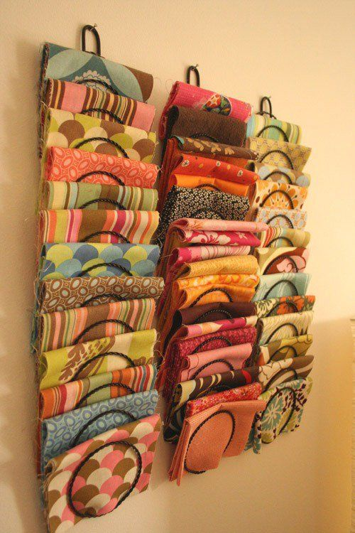 Folded fabric fits nicely into wall-mounted plate racks or mail racks, as Design Mom Gabrielle shows us from a peek into her office.