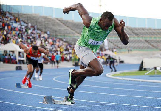 Jamaican runner Usain Bolt starts in the men's 400m race in Kingston