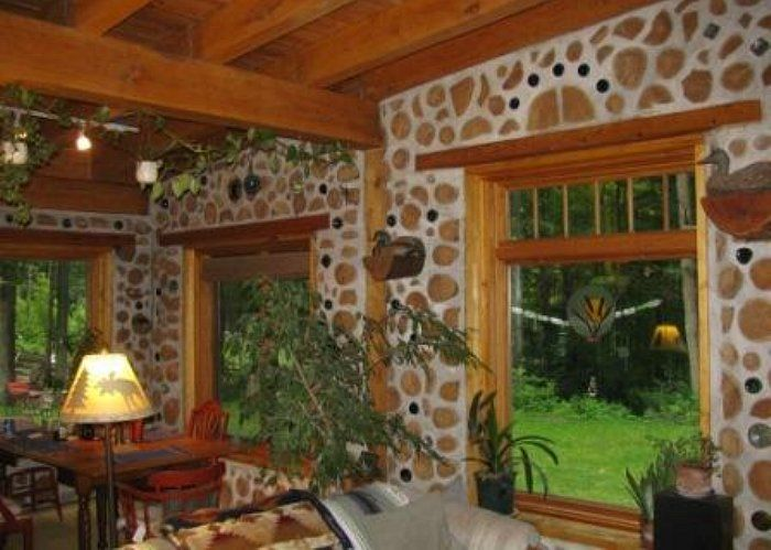 cordwood house. This is like a craftsman or arts & crafts cordwood.