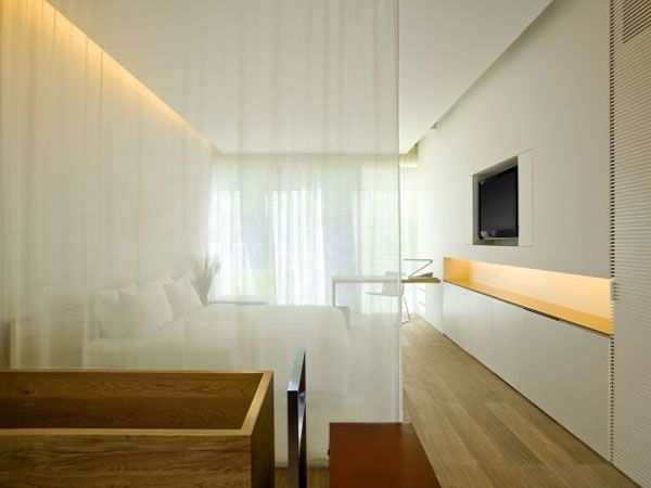 fabric curtain dividing bed + timber bath. Kengo Kuma