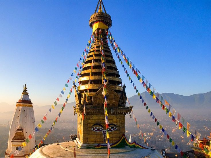 """Considered the most powerful shrine in the Himalayan region, Swayambhunath Stupa (the name means """"self-manifested"""") is built in the classic Nepali style. The white dome represents earth; the 13 tiers of the spire are the stages man must pass through to reach nirvana. [See the complete Nepal itinerary](http://www.cntraveler.com/grand-tour-of-asia/nepal)"""