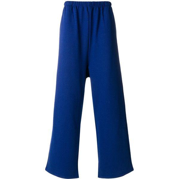 Balenciaga Slackened Tracksuit Pants ($590) ❤ liked on Polyvore featuring men's fashion, men's clothing, men's activewear, men's activewear pants and blue