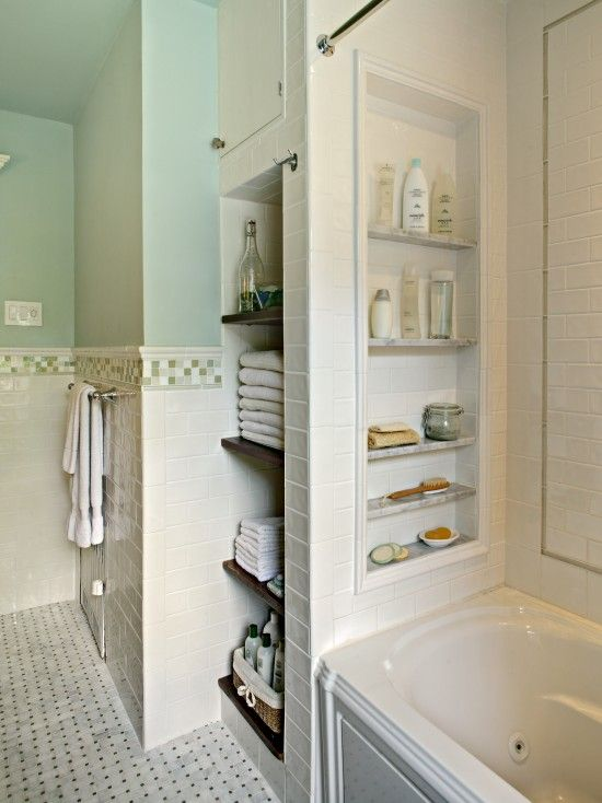Love the shelves in the shower: convenient storage without bottles balanced on the tub rim or baskets hanging into the showering space, begging for elbows to bump into them.