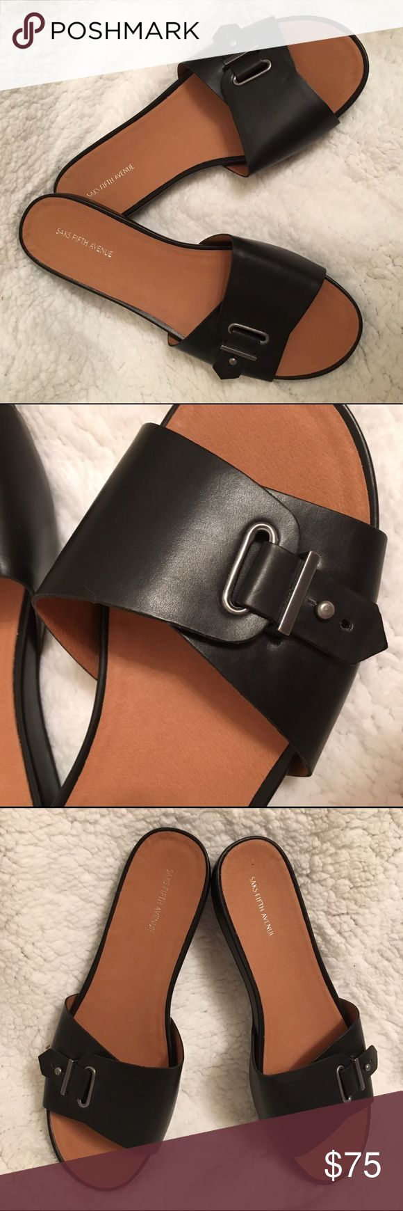 New black sandals, Saks Fifth Avenue, size 11 Saks Fifth Avenue brand. Beautiful black sandals with a buckle. Size 11. Never been worn. Saks Fifth Avenue Shoes Sandals