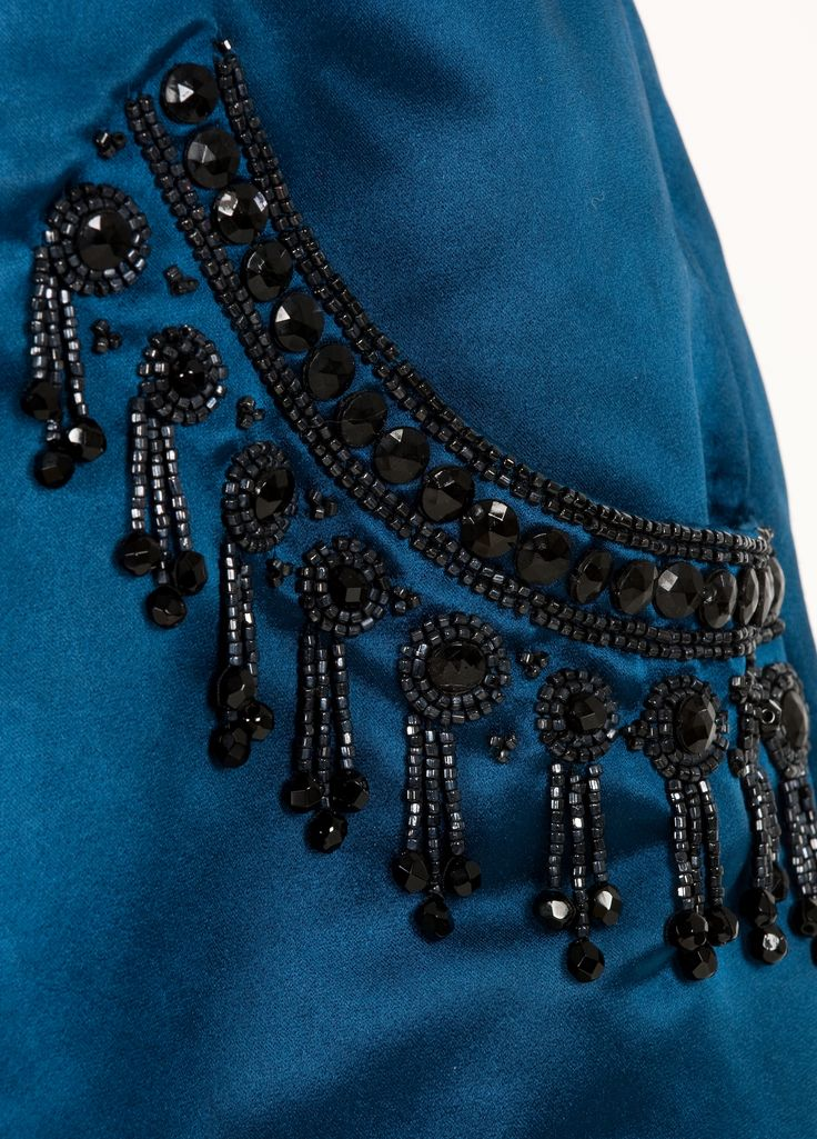 Detail of the embroidery on an evening dress