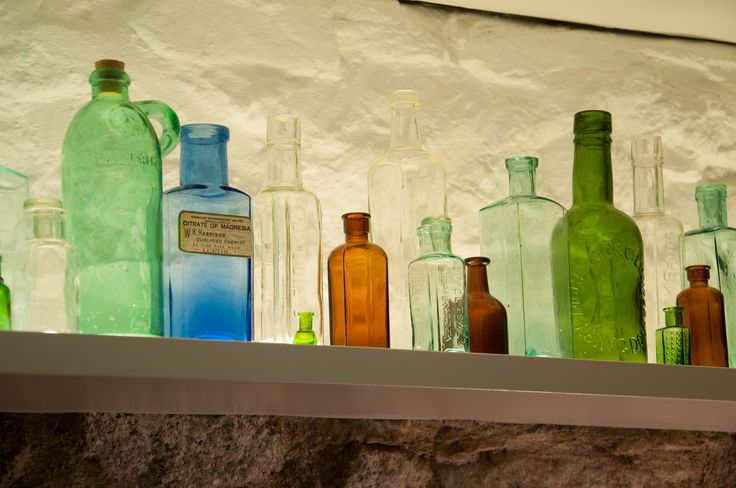 Feature #illuminated display shelf with #upcycled coloured #glass #bottles