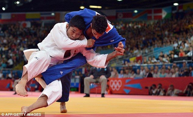 Crash: Great Britain's Ashley McKenzie (right) is thrown by Japan's Hiroaki Hiraoka