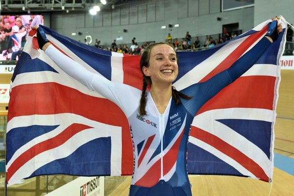 Britain's Elinor Barker holds the UInion Jack after winning the women's points race final at the Hong Kong Velodrome during the Track Cycling World Championships in Hong Kong on April 16, 2017. / AFP PHOTO / Jayne RUSSELL